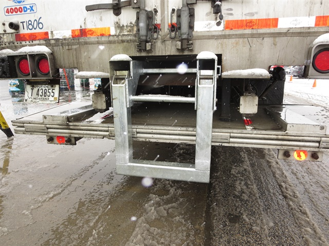 Liftgate-Lok's inverted U-shaped bar pulls out from underfloor storage, drops down and locks in place. When stowed, this slide-out gate is free to deploy. Photo: Tom Berg