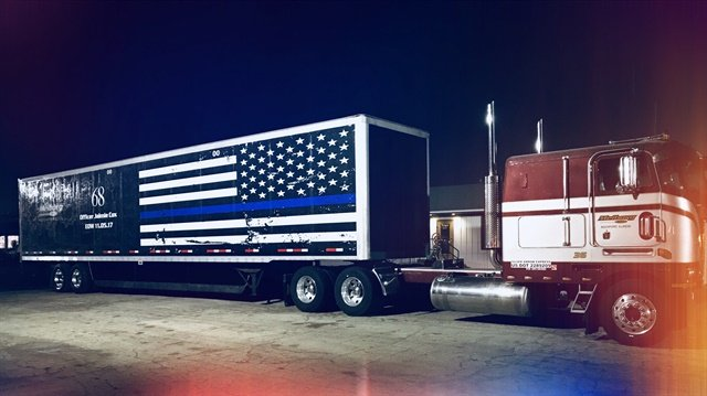 Blue stripe across a mourning version of the American flag honors fallen police officers. This one is for Officer Jaimie Cox of the Rockford, Ill., P.D. Photo: Meiborg Inc.