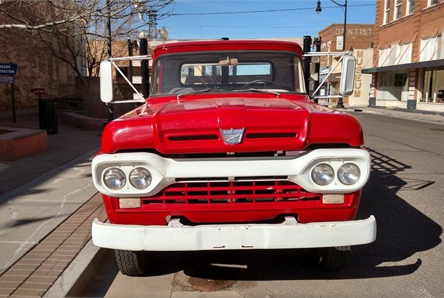 1960 or so F-500 is clean and at least cosmetically restored.Nose emblem has a lightening bolt, indicating there's an inline 6 under the hood.