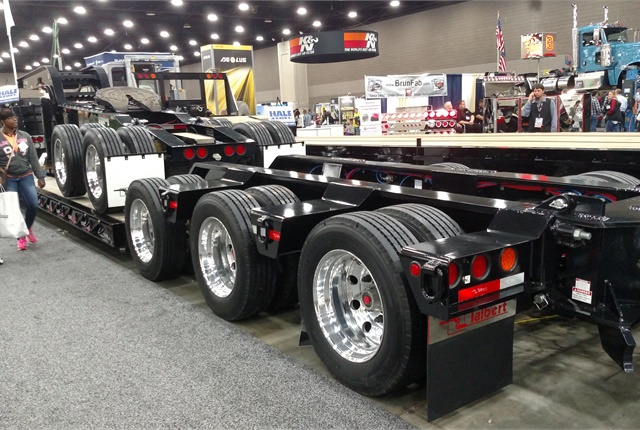 Gloss black looks good against red lights, red-and-white conspicuity tape and polished aluminum wheels at the Louisville truck show. Photo: Tom Berg