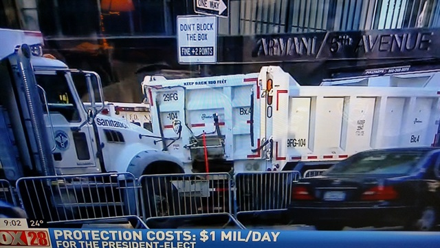 DSNY Mack Granite dump trucks, loaded with sand, were positioned at Trump Tower following now-President Donald Trump's election in November. Security was expensive. TV screen shots by Tom Berg