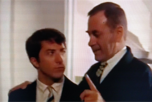"<p><strong>Dustin Hoffman's character, Ben Braddock, listens as Mr. McGuire (Walter Brooke) advises him to seek a future in ""plastics."" <em>Photo: Tom Berg, from ""The Graduate"" (Embassy Pictures, 1967), via YouTube.com.</em></strong></p>"