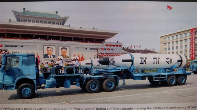 What looks like a Chinese civilian-design tractor-trailer carries a North Korean missile meant for submarine launching. Note the sailors sitting stiffly at attention on the platform behind the cab. Photos: KCNA and wstech.com
