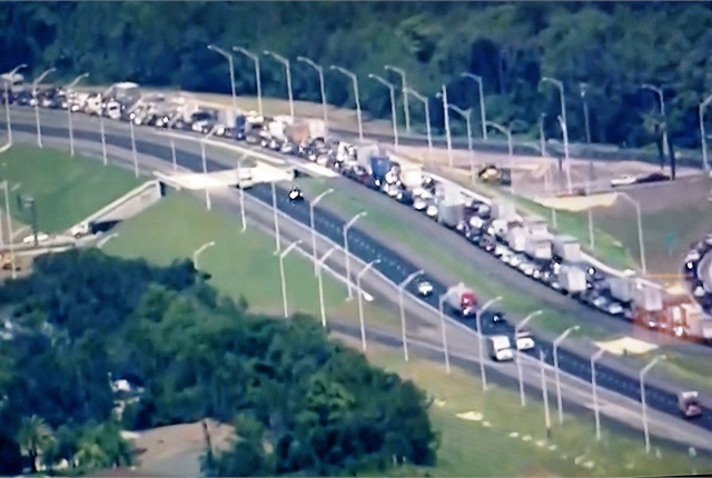 Cars and trucks fleeing Hurricane Irma choke a freeway in south Florida. If they run low on fuel, they're in trouble. Screen capture from NBC News
