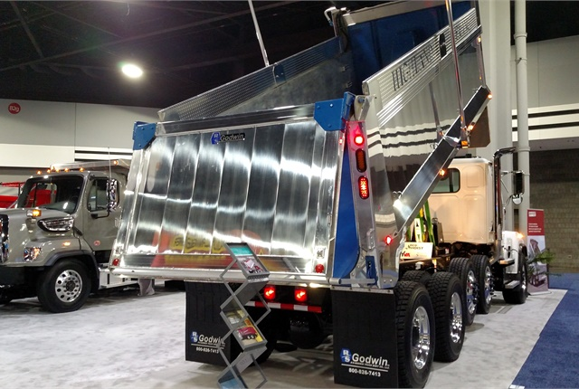 "At first glance, this Godwin dump body appeared to be another aluminum unit. But it's a ""Hybrid"" that also uses high-strength steel, allowing considerable hauling flexibility."