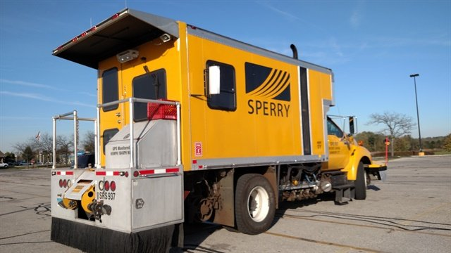 Sperry Rail Services truck with specialized body and equipment is parked outside a Kroger grocery store in Delaware, Ohio. Maybe its crew was inside buying vittles. Sperry operates nationwide.  Photo: Tom Berg
