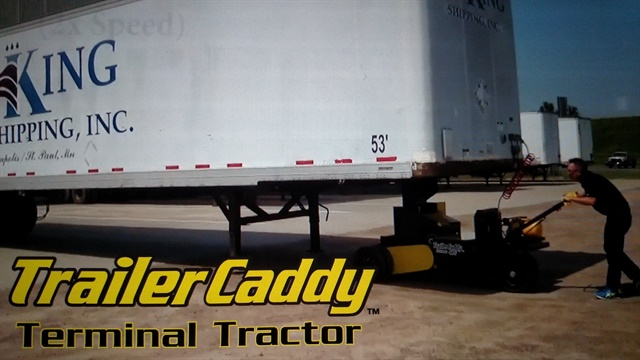 Caddy backs this trailer into a dock. Operator faces forward during the maneuver rather than peering through mirrors.