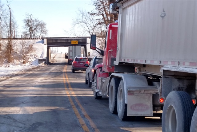 On SR 42 just northeast of Delaware, Ohio, a trucker has stopped to check the clearance between the railroad bridge and the roof of his trailer. It was enough. Photos: Tom Berg