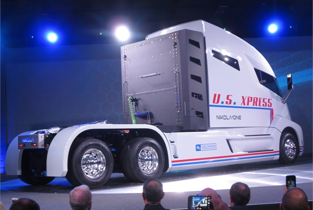 <p><strong>A&nbsp;wrap was removed and the Nikola One prototype revolved before the enthusiastic audience at the Dec. 1 unveiling. Liquified hydrogen is stored in bottles behind the long sleeper-cab.&nbsp;<em>Photos: Tom Berg&nbsp;</em></strong></p>
