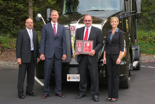 From left, Ray Lehrman, automotive supervisor for UPS; Preston Feight, Kenworth general manager; Robert Filosa, West Region Automotive Coordinate for UPS; and Katie Guest from MHC Kenworth in Atlanta. Photo by Deborah Lockridge