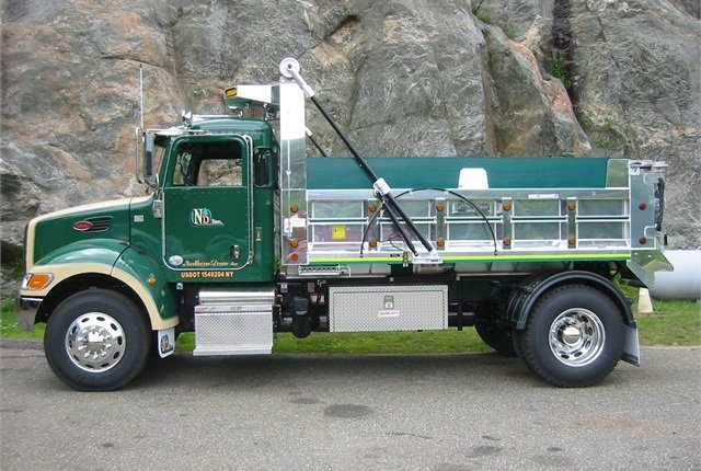 Few work trucks are as fancy as this Peterbilt with its J&J aluminum dump body. Its owner in New York enjoys taking it to shows.