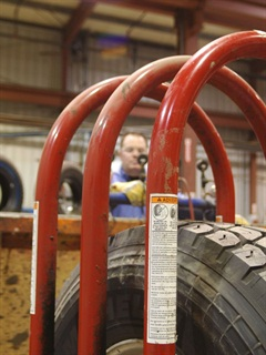 The one tool every tire shop needs is a tire inflation cage. It's designed to absorb the blast from a tire exploding during inflation.