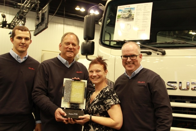 Work Truck's Executive Editor, Lauren Fletcher (second from right) presents the award to (l-r) ICTA's Tim Ellsworth, product planning manager; Shaun Skinner, president; and Brian Tabel, executive director, marketing. (Photo by Roselynne Reyes)