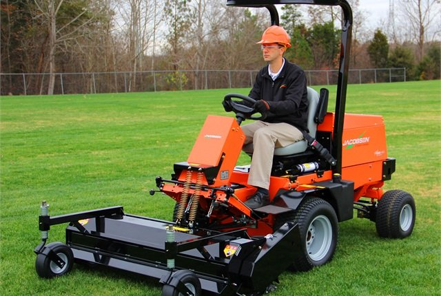 A flail deck attached to Jacobsen's TurfCat discharges grass and debris down into the turf with double-edged blades. Photo courtesy of Jacobsen