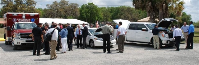 Attendees of the groundbreaking ceremony view vehicles that run on CNG. Photo courtesy of Marion County.