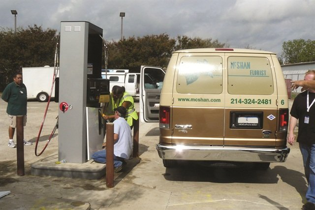 Employees of Dallas-based McShan Florist fill up one of 25 Ford E-350 vans on CNG. Owner Bruce McShan says he would not have been able to secure a grant for the CNG conversions without the help of a grant writer.