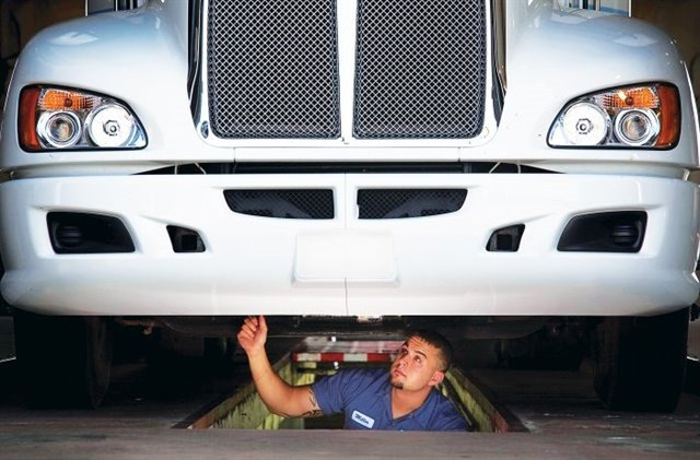 One way to use Lean in the shop is to look for ways to cut wasted time and movement by technicians. Photo: XPO Logistics