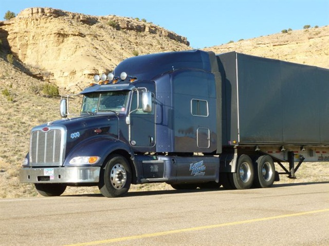 Niss' first project truck is this 2013 Peterbilt 386 pulling an aluminum flatbed.