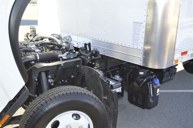 The small 3-liter diesel nestles between the frame rails and is in plain view when cab's tilted. The blue-capped tank carries diesel exhaust fluid for the aftertreatment system on the right side of the truck.
