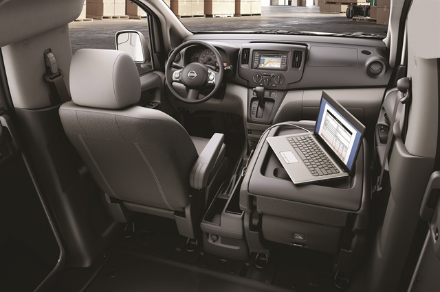 On the back of the passenger seat's surface in the NV and NV200 vans, Nissan added a desktop where a fleet driver can write and put his or her laptop. Photo courtesy of Nissan.