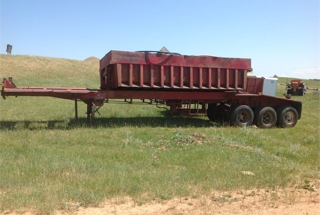 Lots of steel went into this '66 Easton side-dump trailer that just sold on-line for $2,500. The internet has changed how auctioneers do business, but Dan Pate of Pate Auction Service still prefers to personally inspect equipment.