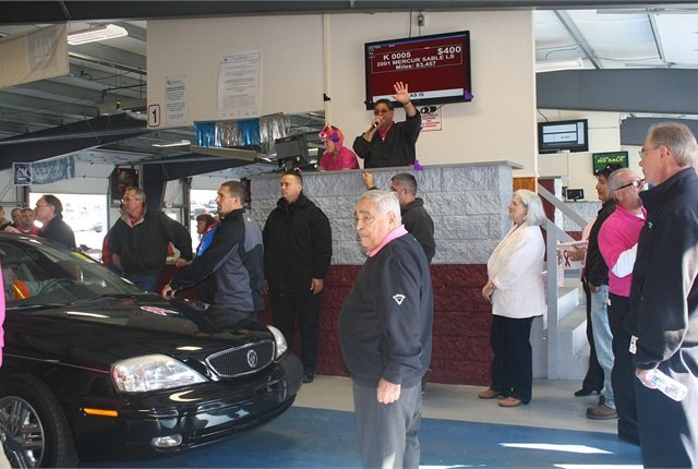 Pittsburgh Auto Auction President, Denny Angelicchio auctioning off one of the vehicles designated for donation to the Susan Koman Foundation.