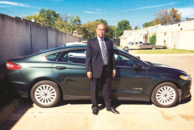 Detroit Executive Fleet Manager Craig Rice is pictured here with one of the new 2015 Ford Fusion hybrids, which get twice the fuel economy of the vehicles they replace. Photo courtesy of City of Detroit