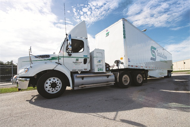 Starting in 2012, Saddle Creek began a partnership with Freightliner to design and implement long haul CNG trucks with a range of 600-plus miles per fill.