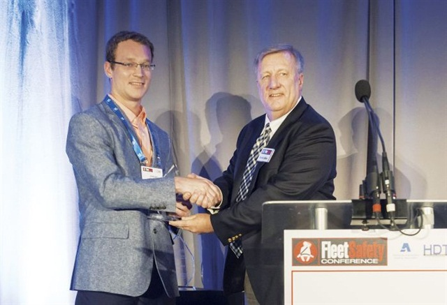 HDT Executive Editor David Cullen (right) presents Nussbaum Transportation's Jeremy Stickling with the inaugural HDT Safety and Compliance Award. Photo: Mark Campbell