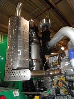 A 2013-model MTU 1300 engine includes electronic on-board diagnostics, a new Environmental Protection Agency requirement.  Because it's otherwise an EPA 2010-spec engine, it has a DPF (left) and urea dosing chamber as part of its vertical exhaust stack.