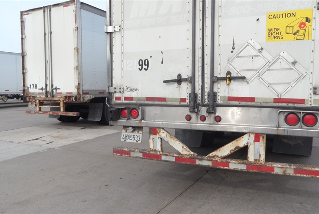 It's difficult to find a damaged rear impact guard because owners and drivers know they must be fixed before going on the road. Surface rust and dirt shouldn't result in a citation, but deeper corrosion and bends might. Every trailer builder's guard is different, so parts from individual manufacturers must be used in repairs.