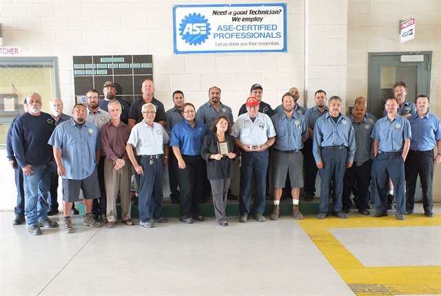 The City of Santa Ana's staff manages a fleet of 651 units. Fleet staff is pictured here celebrating with their awards.