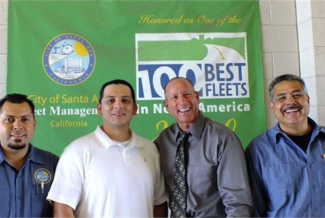 Intern Felipe Maldonado (in white) stands with fleet staff (l-r) Ulice Contreras, fleet manager Rick Longobart, and Ruben Esparza. Photo courtesy of City of Santa Ana.