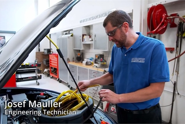 In a scene in IIHS' new video,Josef Mauller prepares a vehicle for a crash test at the IIHS Vehicle Research Center.