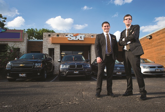 Andrew Almand (left) and his chief operating officer (Daniel) stand in front of their new Sixt franchise in downtown Austin. They are planning to open three to four additional Sixt locations within the next two years.