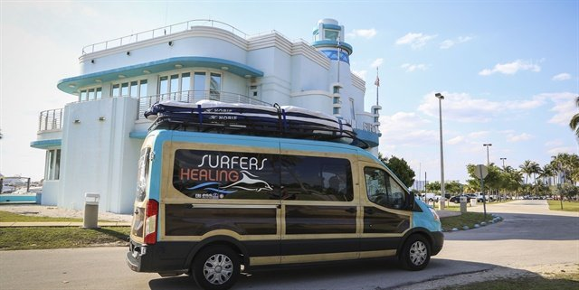 Surfers Healing's new Transit woodie-style van features a surf rack that can transport 10 tandem surfboards at one time.