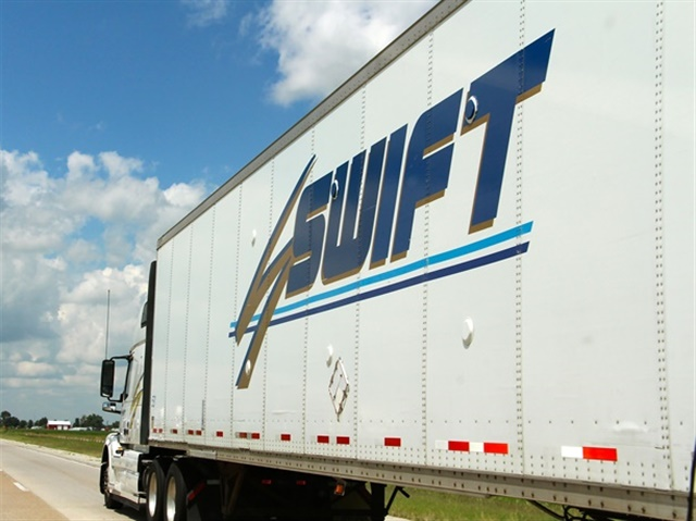 "Swift Transportation is diversifying its service offerings to appeal to both customers and drivers. For example, the carrier offers an expedited team service aimed at ""high-value loads"" that relies on more than 4,000 drivers, while its new Swift Express routing option allows drivers to transport loads within a close range of their homes. Photo: Evan Lockridge"