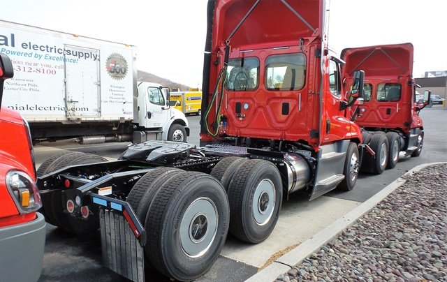 System Freight Inc.'s fuel-efficient Cascadia Evolution tractors are spec'ed to be light weight.