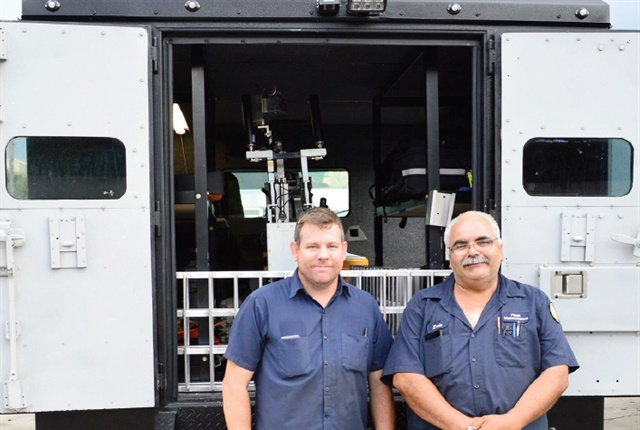 Tim Hahn and Ernie Reina (l-r) refurbished and upfitted this Tampa Police Department bomb truck, saving the city nearly $200,000. Photo: Thi Dao