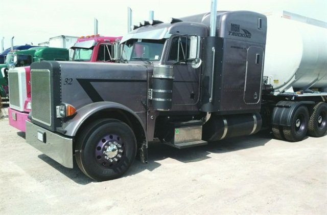 MBH Trucking's Peterbilt has a blacked-out look because its aluminum parts have been coated with Linex bed-liner material to protect the metal from oxidation.