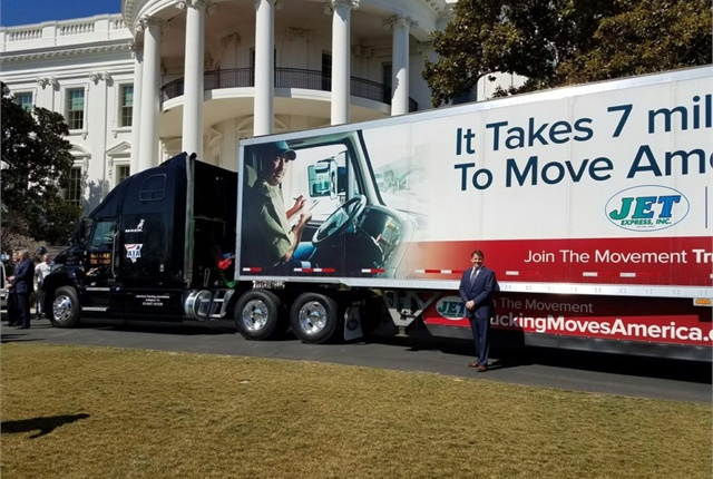 "ATA's Share the Road truck was pulling a trailer provided by Jet Express featuring the ""Trucking Moves America Forward"" imaging campaign. Photo: ATA"