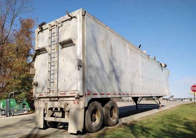 A loaded Titan Thinwall trash-transfer trailer awaits transport outside a county facility near Delaware, Ohio. Though far from new, its aluminum welded-tube sides remain straight and unbowed.Photo: Tom Berg