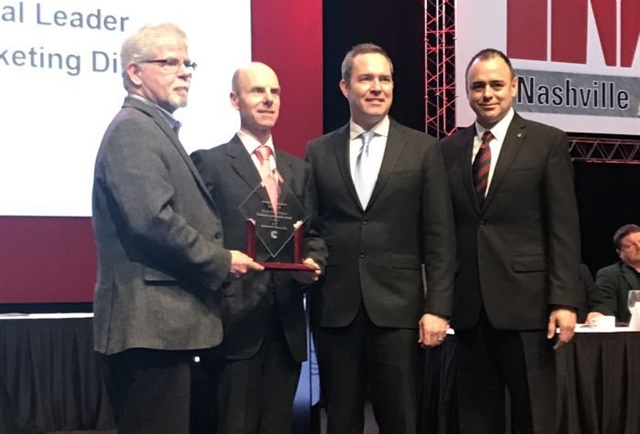 At the TWNA awards ceremony are (left to right) Jim Park, chairman of the TWNA awards committee; Tim Proctor, X15 technical director, Cummins; Jim Nebergall, X15 program director, Cummins; and Mario Sanchez-Lara, communications director, Cummins. Photo: TWNA