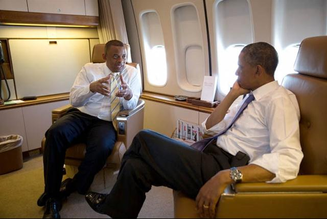 President Barack Obama talks with Transportation Secretary Anthony Foxx aboard Air Force One during the flight to Jacksonville, Fla., where the president called for more infrastructure investment to create jobs and support the middle class. (White House photo)