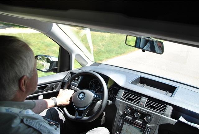 European correspondent Sven-Erik Lindstrand photographs himself sampling controls of a VW Caddy small van.