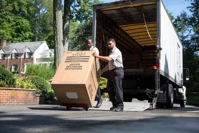 Final-mile delivery, like this one by XPO Last Mile, requires not only getting the product there in a specific time window, but often can involve getting it into the customers' home and even setting it up. Photo: XPO Logistics
