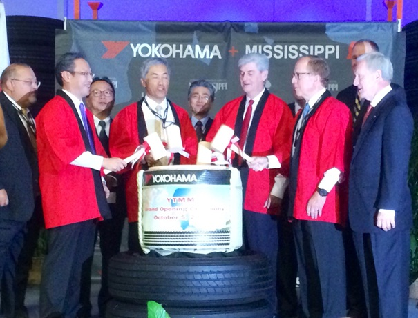 Government and company officials take partin a traditional Japanese ceremony at grand opening of new Yokohama truck-tire plant in West Point, Miss. Photo: David Cullen