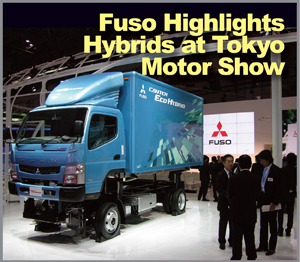 The Canter cab and body are lifted to reveal components of Fuso's new light/medium-duty Eco diesel-electric parallel hybrid at Tokyo Motor Show. The system might be employed later in Freightliner M2 trucks. (Photo by Sven-Erik Lindstrand)