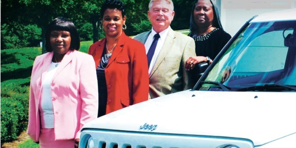 (L-R) Judith Jones, director of Administrative Services; Sherry Clay, fleet administrator 1;...