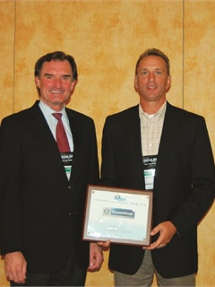 Tom Armstrong, ThyssenKrupp's director of fleet (right), accepts a certificate for ThyssenKrupp's participation in the National Clean Fleets Partnership.